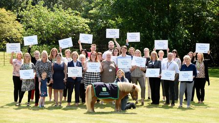 Jack Brock with a number of dementia friends from across Suffolk Picture: ROB HOWARTH
