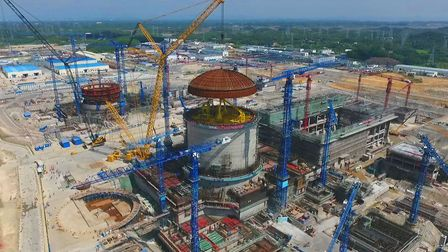 The dome is lifted on to the Fangchenggang Unit 3 nuclear power plant in China, marking a major mile