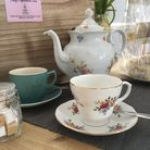 Vintage mismatched crockery adds to the character. Picture: ELLIS BARKER
