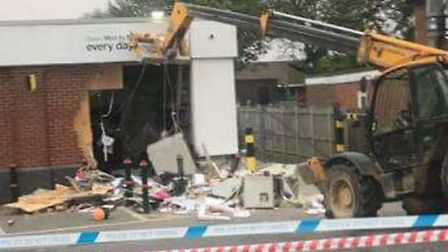 A JCB outside the East of England Co-op foodstore where a cash machine was targeted by ram raiders o
