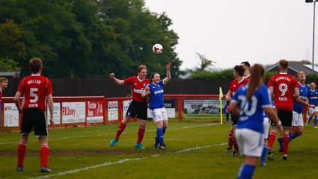 A close call as Town Talk and Ipswich Town Ladies vye for the ball Picture: PHIL CHAPLIN