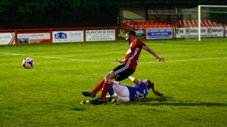 Ross Halls is tackled by Jordan Arnoup Picture:PHIL CHAPLIN
