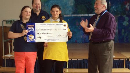 The New Century Lions present a cheque of £600 to Stone Lodge Academy Picture: STONE LODGE ACADEMY