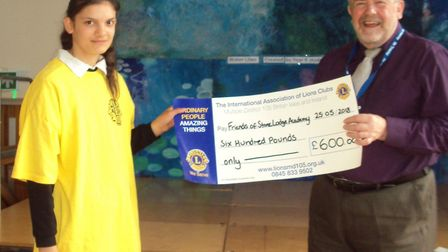 Stone Lodge receive a cheque for £600 Picture: STONE LODGE ACADEMY