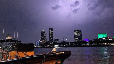 Lightning illuminating the sky over the Southbank on the River Thames in London Picture: TOWERRNLI/