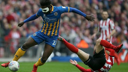 Rugged defender Aristote Nsiala has been a hit for Hurst at both Grimsby and Shrewsbury. Photo: PA
