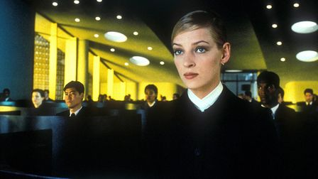 Uma Thurman, as a cool perfect employee, in the science fiction thriller Gattaca which looks at a di