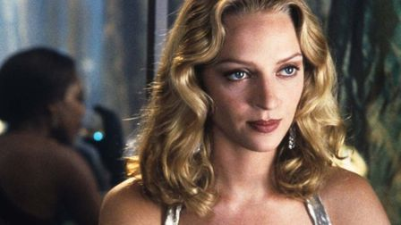 Uma Thurman, as the perfect employee but rebellion bubbles beneath the surface, in the science ficti