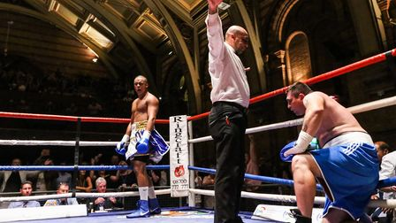 Fabio Wardley, left, celebrates as ref Ian John Lewis waves off the action in the first round at the