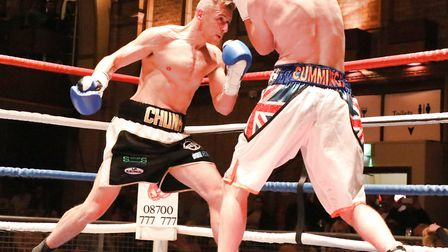 Ryan Copland throws a heavy body shot against Paul Cummings in his pro debut at the Ipswich Corn Exc
