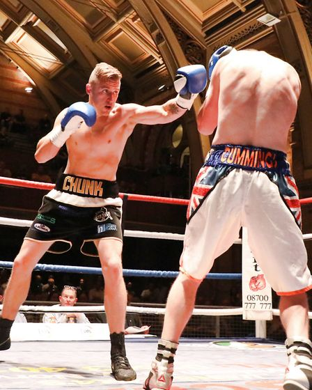 Ryan Copland lands a jab on his pro debut at the Ipswich Corn Exchange. Picture: GEOFF SMITH/TOP-PIC