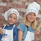 Hannah and Phoebe have a go at cooking Picture: SARAH LUCY BROWN