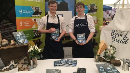 Woodbridge School pupils, Nathan Little and Callum Sycamore, both 17, with the cookbook curated by p
