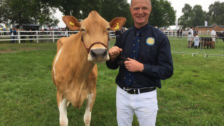 Jason Salisbury with reserve Any Other Dairy Breed supreme champion Sharnford Morey Mint Picture: SA