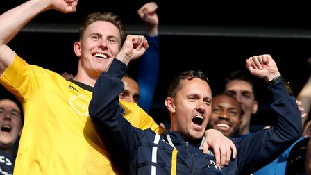 Paul Hurst (right) celebrates with goalkeeper Dean Henderson after Shrewsbury Town booked their plac