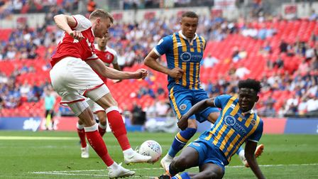 Toto Nsiala (pictured tackling) says Paul Hurst helped him overcome anger management issues. Photo: