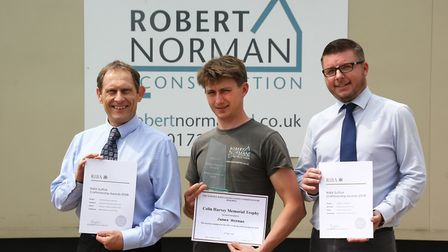 From left, site manager James Norman, contract manager Mark Leeks and Bob Page, managing director of