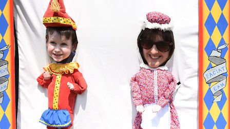 A mother and son have a go at being Punch and Judy Picture: SARAH LUCY BROWN