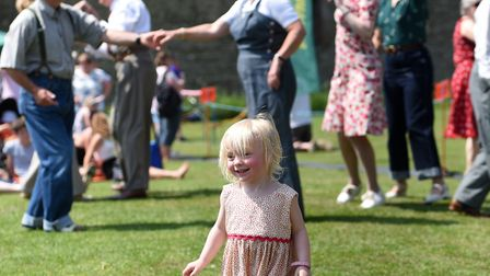 A little girl joins the swing dancers Picture: SARAH LUCY BROWN