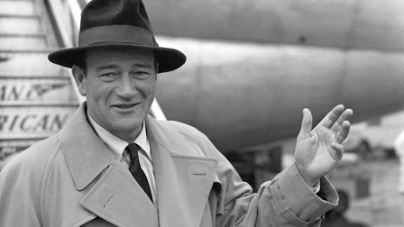 John Wayne arriving at Heathrow Airport for his first visit to England.