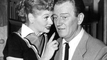 Publicity photo of John Wayne and Lucille Ball from the television program I Love Lucy. Photo: CBS T