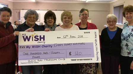 Pictured with their cheque for the Every Heart Matters appeal are members of the Beck Row Thursday C