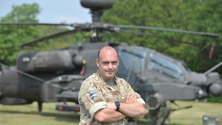 Major James Milnes with the Apache helicopter from Wattisham Picture: SARAH LUCY BROWN