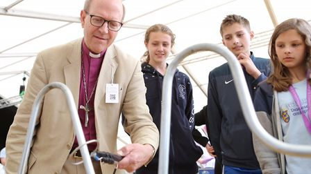 Bishop Martin Seeley taking part in fun games at the Church of England marquee at the county Suffol