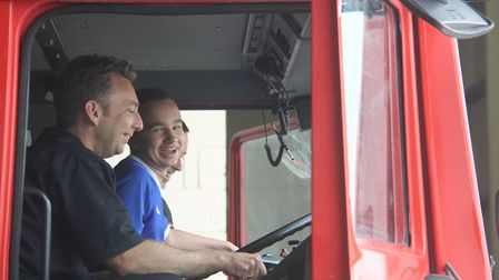 Liam Covey from Kesgrave enjoying a ride in a fire engine Picture: EACH