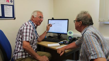 A Citizens Advice session in the charity's new interview room. Pictured are Dennis Merritt and Patri