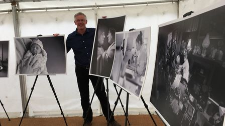 Photographer Warren Page with his exhibition at the Suffolk Show to celebrate 70 years of the NHS