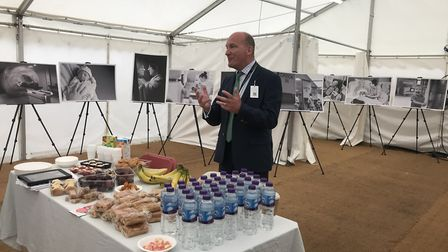 Nick Hulme, chief executive of Ipswich and Colchester hospitals, unveils a photographic exhibition a