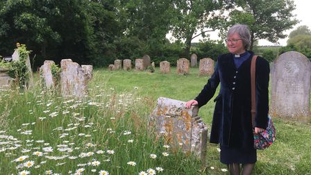 Reverend Sandie Barton in the churchyard at St Andrew's in Freckenham Picture: ROSS BENTLEY