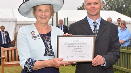 Neil Whatling receives his Long Service Award from Suffolk Show President Baroness Byford for 35 yea