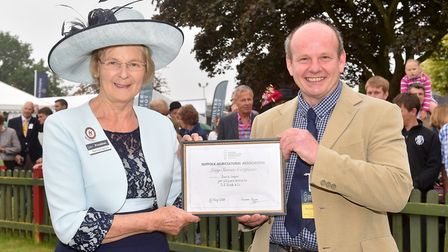 David Cooper receives a Long Service Award for his 40 years of service from Suffolk Show President B