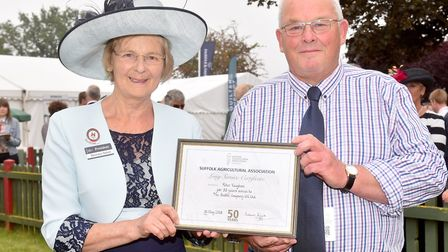 Peter Vaughan receives an award for 50 years of service from Suffolk Show President Baroness Byford