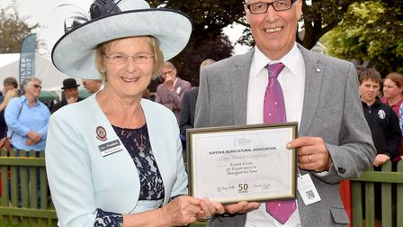Richard Chilvers with his award for 50 years of service, presented by Suffolk Show President Barones