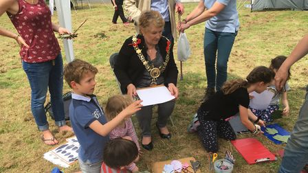 Sudbury Mayor Sue Ayres joins children as they have a go at leaf rubbing