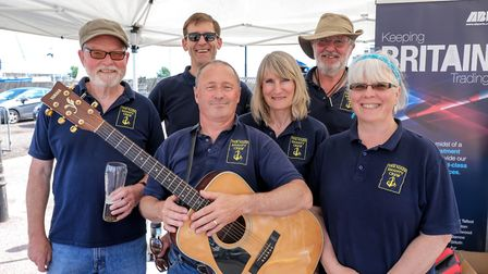 The Name Shanty Crew, who were singing at the boat show which ran alongside the Dragon Boat races