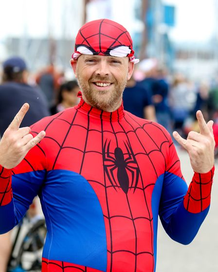 Robert Porter, an oarsman in the Fresh Start Dragon boat, dressed as Spiderman for the races Pictu