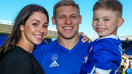 Leoni and Martyn Waghorn, with five-year-old son Ruben, on the pitch for the lap of appreciation fol