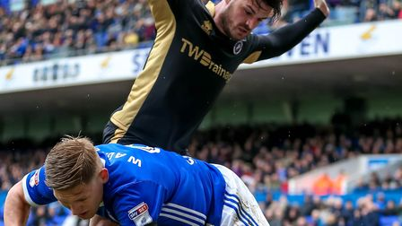 Millwall's Ben Marshall protests his incense as Martyn Waghorn falls Picture: STEVE WALLER WWW.S