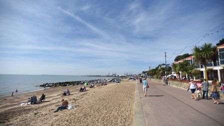 People walking next to the beach in Felixstowe. Picture: GREGG BROWN