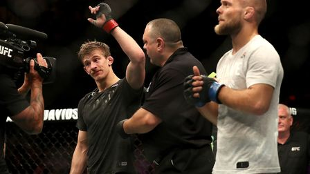 Arnold Allen (left) celebrates victory against Mads Burnell at UFC Liverpool. Picture: PA SPORT