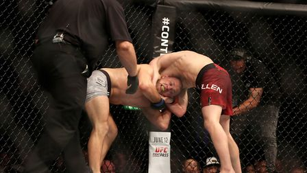 Arnold Allen locks the fight-ending choke on Mads Burnell at UFC Liverpool. Picture: PA SPORT