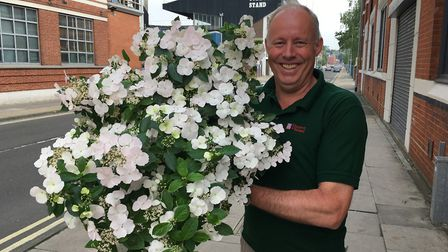 Peter Freeman, Thompson and Morgan's New Product Development Manager, with RHS Chelsea Plant of the