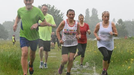 Runners spash through the puddles at last Saturday's Mulbarton parkrun. Picture: IAN EDWARDS PHOTOGR