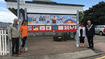 The new mural being unveiled in Felixstowe. L-R: station adopter Richard Holland, Shez Hopkins Level