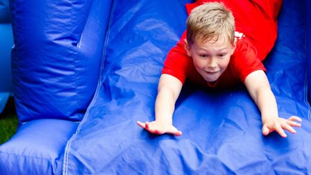 Jamie has a go on a slide during his SSAFA Fun Day in Wickham Market Picture: RAINYWOOD PHOTOGRAPHY