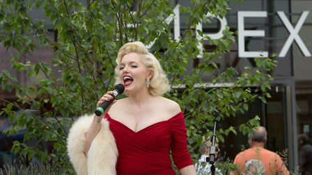 Suzie Kennedy sings outside the Apex Picture: KEITH MINDHAM